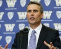 Chris Petersen takes questions from reporters after being introduced as the new head football coach at the University of Washington, Monday, Dec. 9, 2013, in Seattle. Petersen formerly was head coach at Boise State.